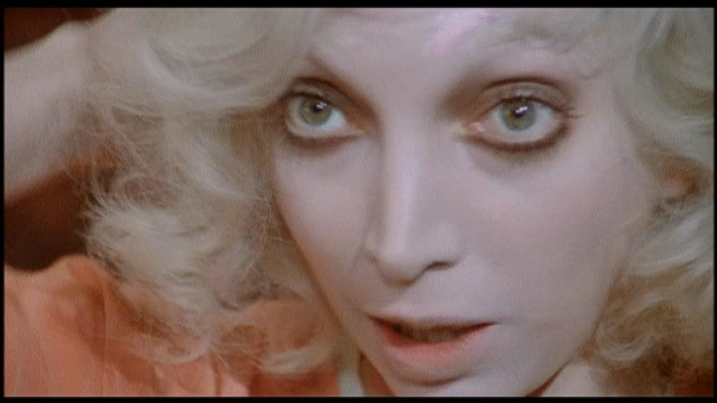 Con Film d'amore e d'anarchia, ovvero «Stamattina alle 10 in Via dei Fiori nella nota casa di tolleranza…» (1973) Wertmüller gioca con la maschera: i capelli biondi sono dello stesso colore dell'incarnato, e il trucco fa convergere lo sguardo sugli occhi sgranati dell'attrice