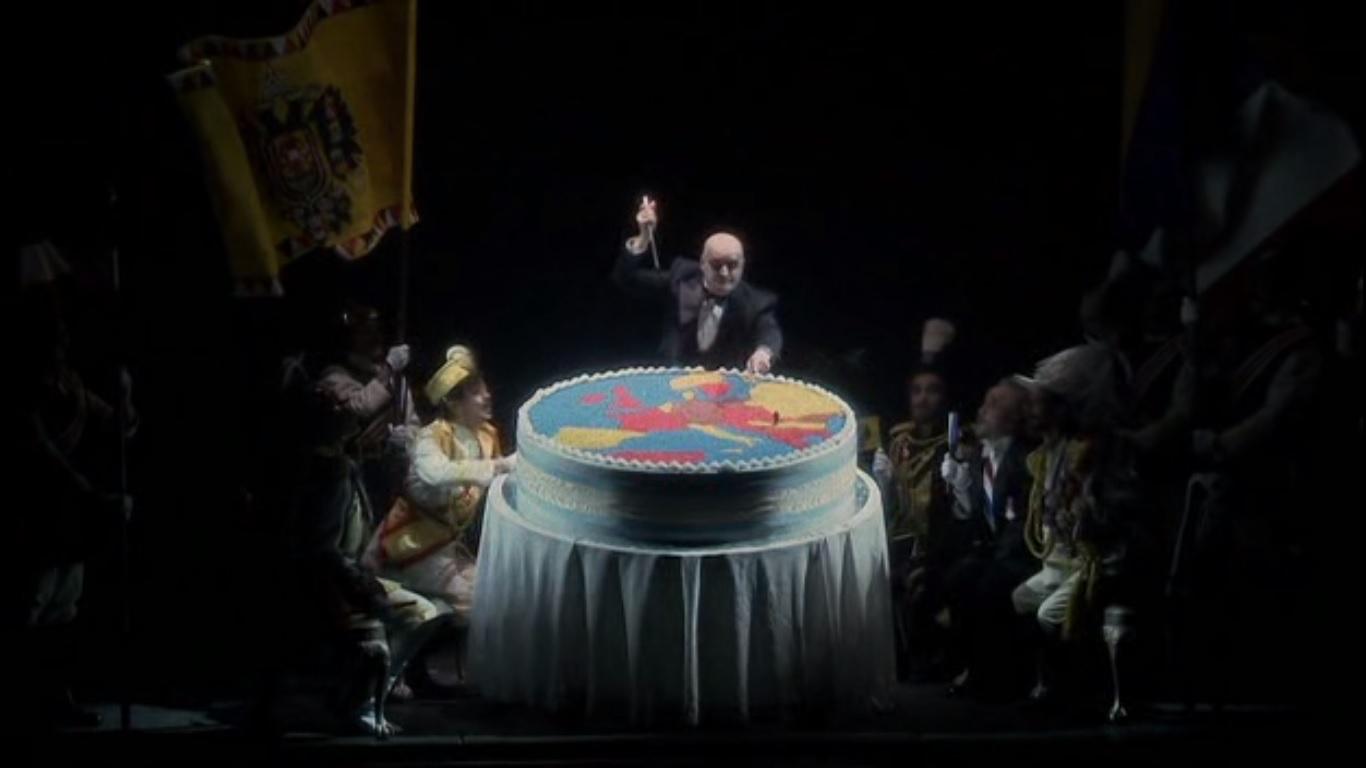 I regnanti europei e Mefistofele nell'atto di dare l'assalto alla torta del Continente, scena tra I e II parte